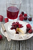 Camembert with raspberries and cherries