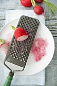 A radish on a grater