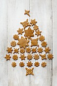 A Christmas tree made from star-shaped gingerbread on a light wooden surface