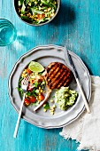 Grilled pork chops with salad and guacamole (Mexico)