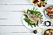 Porgy with mange tout and asparagus, prawns, salad and potatoes