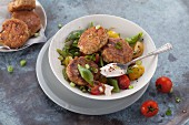 Tuna meatball with a broad bean and cherry tomato salad