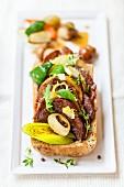 A beef, leek and onion sandwich