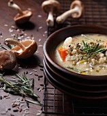 Soup with shitake mushrooms, wild rice and rosemary