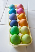 Colourful, dyed Easter Eggs in an egg boxx