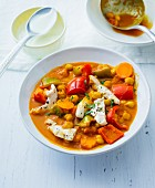Colourful chickpea and pepper stew with chicken