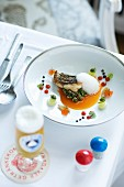 Branzini with beans, solyanka broth and sour cream foam
