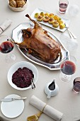 Roast Christmas goose with red cabbage, dumplings, gravy and red wine
