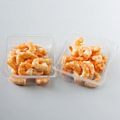 Cooked prawns in plastic dishes