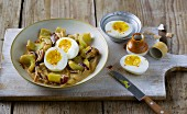 A gherkin medley with onions and hard-boiled eggs