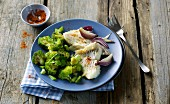Steamed rosefish with broccoli