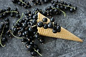 An ice cream cone with blackcurrants