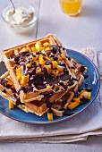 Waffles with chocolate sauce and diced mango