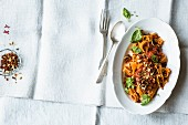 Red tagliatelle with tomato sauce and red gremolata