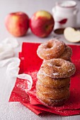 A stack of apple doughnuts with sugar