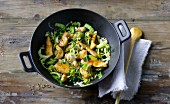 Green Chinese stir-fry with chicken breast, bok choy and leek