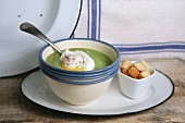 Spinach soup with poached egg and croutons