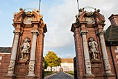 Two pillars with two mercenaries as guards at the entrance gate to Schloss Corvey, Höxter, East Westphalia