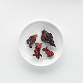 Dried hibiscus flowers and mallows on a plate