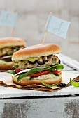 Fish burgers with rosefish, tomatoes and capers