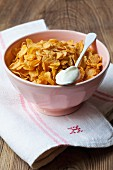 Cornflakes and a spoonful of yoghurt
