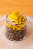 Grated yellow beets on quinoa