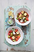 Durum wheat salad with cucumber, tomatoes, cheese flowers and natural yoghurt with chives
