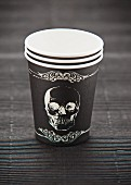 Paper cups with a skull motif