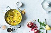 Oriental rice with turmeric and cashew nuts served with pomegranate seeds