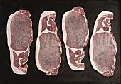 Raw bacon on a baking tray