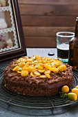 Chocolate cake with stout and kumquats