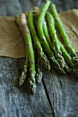 Fresh asparagus on a wooden board