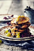 Coconut pancakes with gooseberry jam and blackcurrants