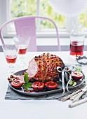 Roast ham with plum glaze for Christmas dinner