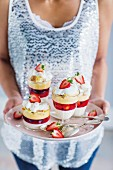 Panna cotta trifles with berry jelly for Christmas dinner
