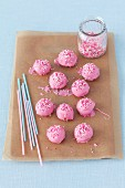 Pink cake pops on a piece of baking paper
