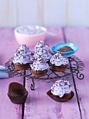 Mini chocolate muffins with purple butter cream