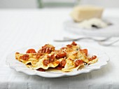 Ravioli with tomatoes and Parmesan cheese