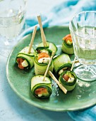 Cucumber rolls filled with avocado and salmon