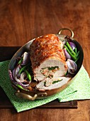 Roast pork roulade with pancetta, spinach and lemon