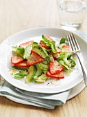 Avocado and cucumber salad with strawberries and basil