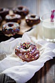 Chocolate-covered doughnuts with colourful sprinkles