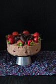 Chocolate cheesecake with fresh strawberries and chocolate curls