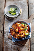 Sweet and sour chicken with pineapple, chillis and oranges