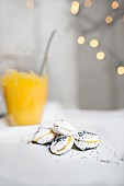 White macaroons with poppy seeds and lemon curd