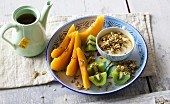 Fresh honeydew melon and kiwi with seeded soy yoghurt