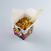 Fried rice with chicken in a takeaway box