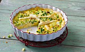 Pea quiche with spring onions, dried tomatoes and a yoghurt topping