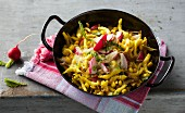 Gratinated soft egg noodles with sweetcorn and fresh radishes
