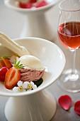 Vanilla and strawberries ice cream with rose wine